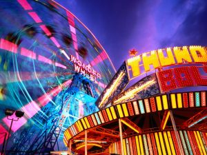 Ferris wheel with pink lights in motion