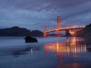 The Golden Gate bridge illuminated at dusk