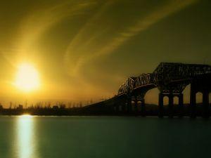 A bridge and sun