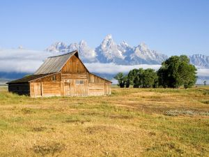 Wooden barn with mountains in background