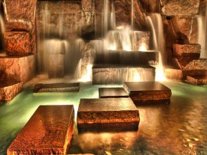 Rectangular stones at the foot of the waterfalls