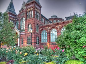 Flower garden surrounding a beautiful building