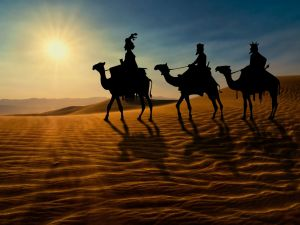 The three Wise Men crossing the desert on camels