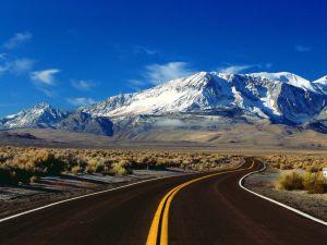 Road towards snowy mountain