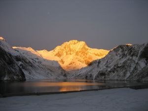 Vallibierna Peak at sunrise from the reservoir Llauset
