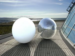 White ball and silvery ball