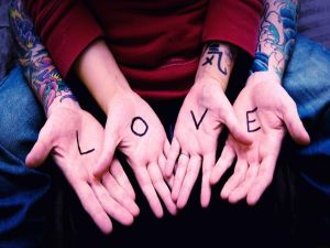 "Hands with the message ""Love"""