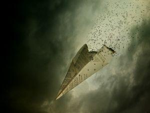 A paper airplane burns