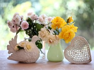 Flowers in a vase and a ceramic dove
