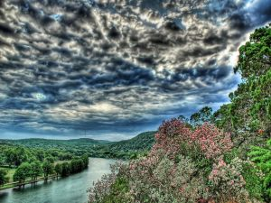A river and covered sky with clouds