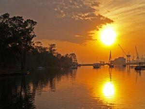 The sun illuminating the port