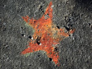 Red star on asphalt