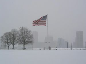 Snow in a park with American flag