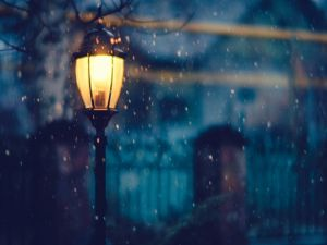 A lighted lantern on a winter night