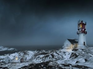 Lighthouse at dusk in a cold place