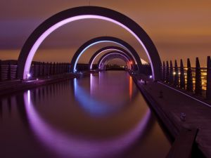 Lighted arches over water