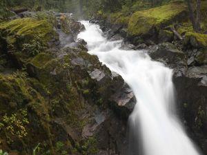 A narrow river between large stones