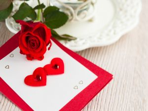 A rose and a card with hearts for Valentine's Day
