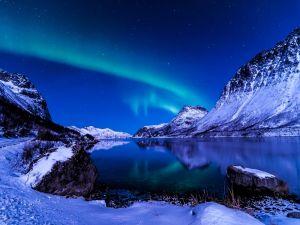 A beautiful winter night near the blue lake