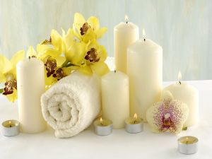 Candle, flowers and towel to rest the body