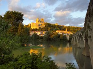 The Orb river and the city of Beziers, France
