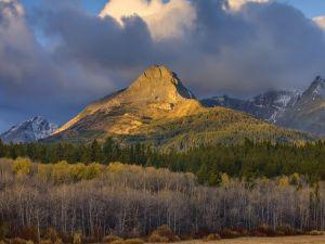 The sun illuminates the mountain