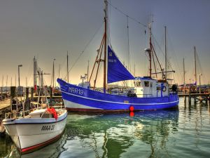 Blue sailboat docked