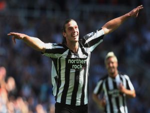 Andy Carroll playing for Newcastle United